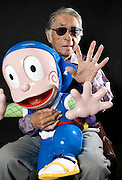 Abiko Moto, better know as one half of the manga writing duo Fujiko Fujio, poses with a model of one of his manga creations, Ninja Hattori-kun, at his offices in Tokyo, Japan on FrIday 26 Feb.  2010.