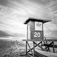 Lifeguard Tower 20 Newport Beach CA black and white picture. Lifeguard Tower #20 is located at 20th Street on Balboa Peninsula along the Pacific Ocean in Orange County Southern California.