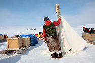 Canadian Rangers riding snowmobiles  set up camp on Cornwallis Island, Nunavut during Nunalivut 2012 sovereignty exercise by Canadian Forces in arctic Canada.