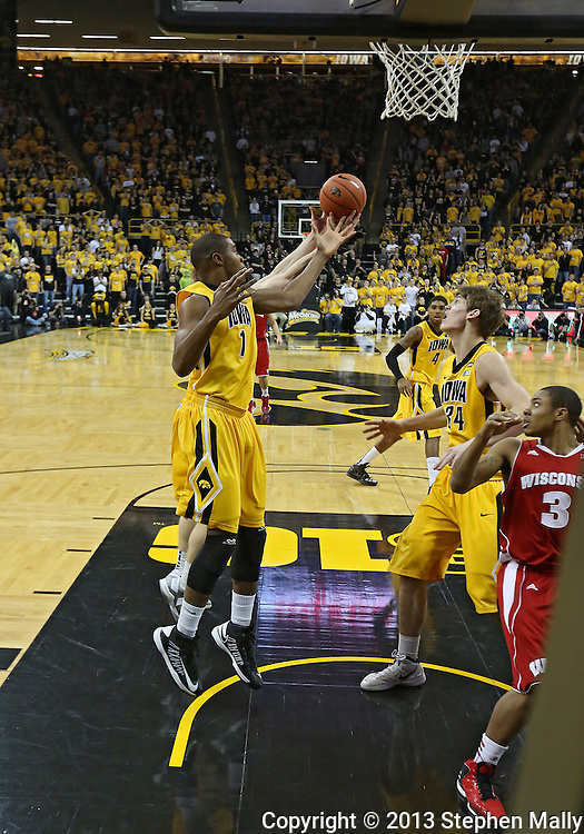 January 19 2013: Iowa Hawkeyes forward Melsahn Basabe (1) tries to pull in a rebound as Iowa Hawkeyes center Adam Woodbury (34) looks on during the first half of the NCAA basketball game between the Wisconsin Badgers and the Iowa Hawkeyes at Carver-Hawkeye Arena in Iowa City, Iowa on Sautrday January 19 2013. Iowa defeated Wisconsin 70-66.