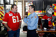 Experienced Company Event, Marketing and Social Media Promotion Photographer in Kansas City - Former NFL players Tim Grunhard and Eddie Kennison enjoy the Built Ford Tough Toughest Tailgate event with fire fighters from the Kansas City Fire Department's Engine 19 Company on Thursday, Dec. 22, 2016 in Kansas City, Mo. Photo by Colin E. Braley for Ford