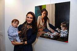CARMEN HAID and her son RAPHAEL HARPEL at a private view of paintings by Laura Smith at 54 The Gallery, Shepherd Market, London W1 on 8th July 2008.<br />