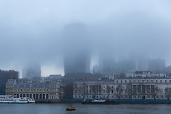 © Licensed to London News Pictures. 22/12/2016. LONDON, UK.  City of London skyscrapers are shrouded in patchy fog this morning. After a cold and foggy start to the day, London is now seeing bright and sunny weather today. Photo credit: Vickie Flores/LNP