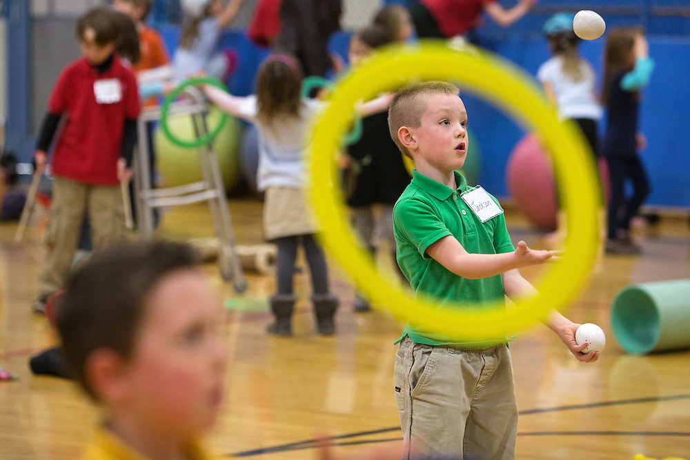 Sorensen first-grader Jackson Reasor, 7, practices juggling two balls Tuesday after receiving instruction from a one of two professional jugglers that are visiting the elementary school.