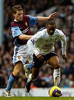 Photo: Ed Godden.<br /> Tottenham Hotspur v Aston Villa. The Barclays Premiership. 26/12/2006. Spurs' Jermaine Defoe (R), advances forward with the ball.