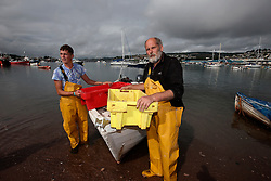 UK ENGLAND DEVON TEIGNMOUTH 10SEP16 - Fishermen Trevor Hall (50) and his son Brendon Hall (19) of Teignmouth land their catch at Teignmouth harbour, Devon, England.<br /> <br /> jre/Photo by Jiri Rezac<br /> <br /> © Jiri Rezac 2016