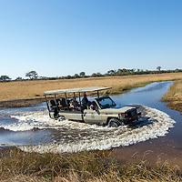 Africa, Botswana, Chobe National Park, Safari truck crosses Savuti Channel