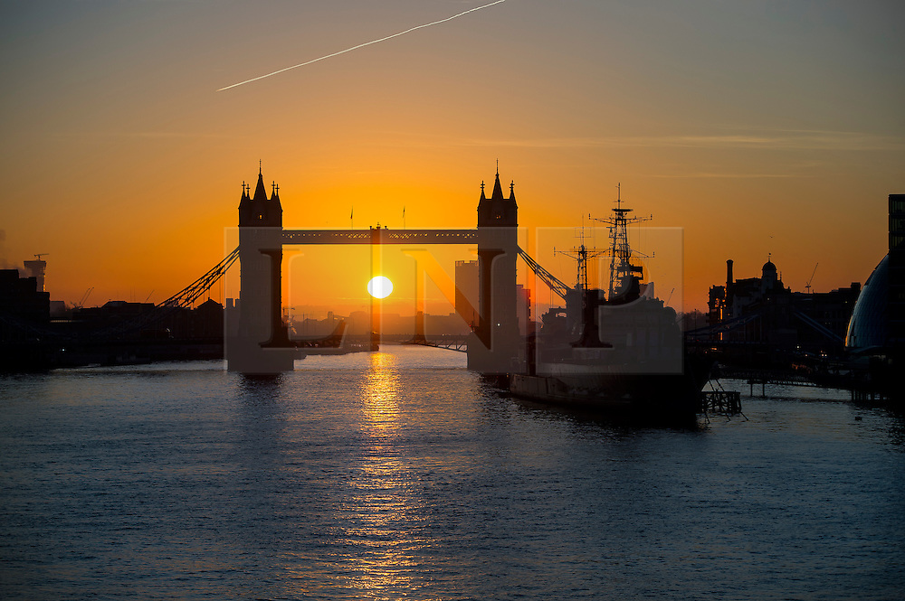 © Licensed to London News Pictures. 16/02/2016. London, UK. Sunrise behind Tower Bridge and HMS Belfast in central London on a cold winter morning. Temperatures in the capital dropped below zero last night. Photo credit: Ben Cawthra/LNP