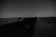 Choum, Mauritania - 21 January, 2016:<br /> Being a long journey, about 16/18 hours of Nouadhibou to Zouarete, people end up resting inside the wagons. When the moon goes down we can enjoy the millions of stars. One of the places in the world where it is simply amazing.
