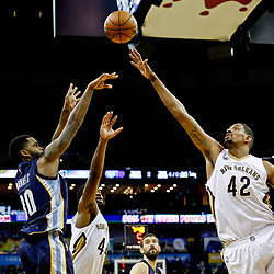 Dec 5, 2016; New Orleans, LA, USA; Memphis Grizzlies forward Troy Williams (10) shoots over New Orleans Pelicans center Alexis Ajinca (42) during the second quarter of a game at the Smoothie King Center. Mandatory Credit: Derick E. Hingle-USA TODAY Sports