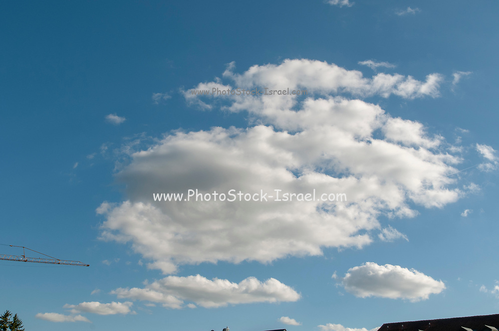 Cumulus Cloud formations with blue sky background. Photographed in Bavaria, Germany