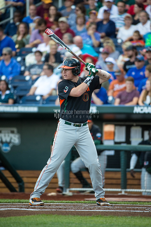 Zack Collins (0) of the Miami Hurricanes bats during a game between the Miami Hurricanes and Florida Gators at TD Ameritrade Park on June 13, 2015 in Omaha, Nebraska. (Brace Hemmelgarn)