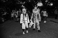 People  dressed as a clown in New Orleans on Halloween.