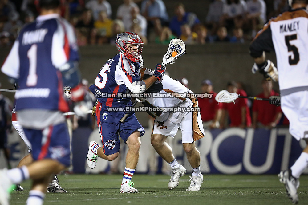 Mitch Belisle #85 of the Boston Cannons runs with the ball during the game at Harvard Stadium on August 9, 2014 in Boston, Massachusetts. (Photo by Elan Kawesch)