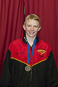 Brandon Keller (RAYS) receives his gold medal for the 11-12 Boys 50 yard Breaststroke (2010 YMCA Upper Southeast Regional Championship, March 20, 2010)