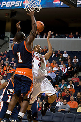 Virginia Cavaliers G Calvin Baker (4) shoots over Carson-Newman F Bobby Guyton (1).  The Virginia Cavaliers men's basketball team defeated the Carson-Newman Eagles 124-65 in an exhibition basketball game at the John Paul Jones Arena in Charlottesville, VA on November 4, 2007.