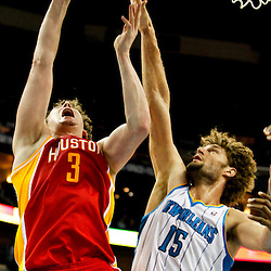 Jan 9, 2013; New Orleans, LA, USA; New Orleans Hornets center Robin Lopez (15) blocks a shot by Houston Rockets center Omer Asik (3) during the second half of a game at the New Orleans Arena. The Hornets defeated the Rockets 88-79. Mandatory Credit: Derick E. Hingle-USA TODAY Sports