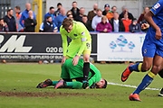 AFC Wimbledon goalkeeper Joe McDonnell (24) saving from Peterborough United midfielder Chris Forrester (8) during the EFL Sky Bet League 1 match between AFC Wimbledon and Peterborough United at the Cherry Red Records Stadium, Kingston, England on 17 April 2017. Photo by Matthew Redman.