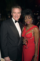 Singer PATTI BOULAYE and her husband MR STEPHEN KOMLOSY, at a ball in London on 27th October 2000.OIK 45