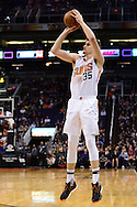 Jan 3, 2017; Phoenix, AZ, USA;  Phoenix Suns forward Dragan Bender (35) shoots the basketball in the first half of the NBA game against the Miami Heat at Talking Stick Resort Arena. The Suns won 99-90. Mandatory Credit: Jennifer Stewart-USA TODAY Sports