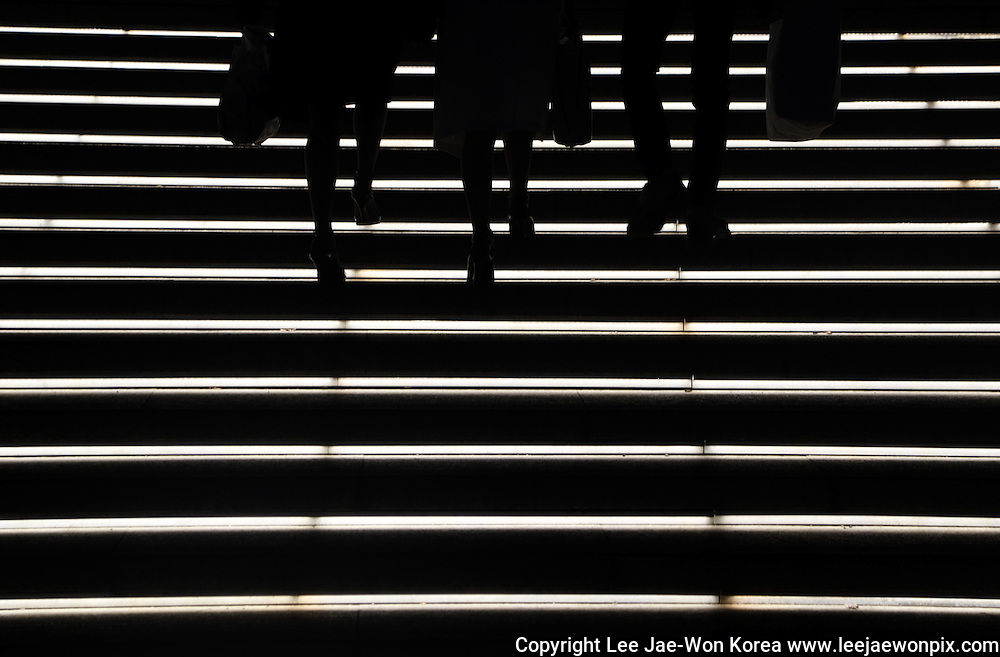 People go up the stairs in central Seoul March 21, 2014. Photo by Lee Jae-Won (SOUTH KOREA) www.leejaewonpix.com/
