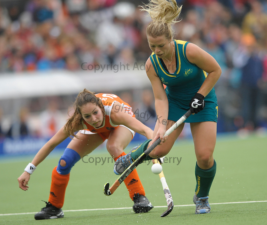 Australia's Jade Warrender gets away from Netherland's Eva de Goede during their opening game in the  Rabo FIH Women's Champions Trophy, Wagener Stadium, Amsterdam, Netherlands, 25th June 2011.