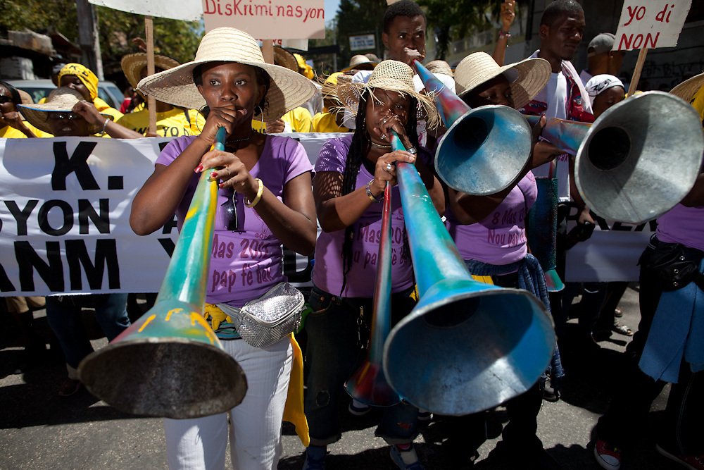 A women's rara, or street band, accompanies the International Women's Day march through Port-au-Prince. (Photo by Ben Depp)