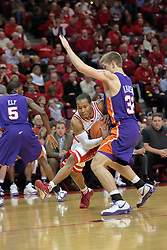 31 December 2008: Lloyd Phillips gets small and whips his way around James Haarsma.  Illinois State University Redbirds extended their record to 13-0 with an 80-50 win over the Evansville Purple Aces on Doug Collins Court inside Redbird Arena on the campus of Illinois State University in Normal Illinois