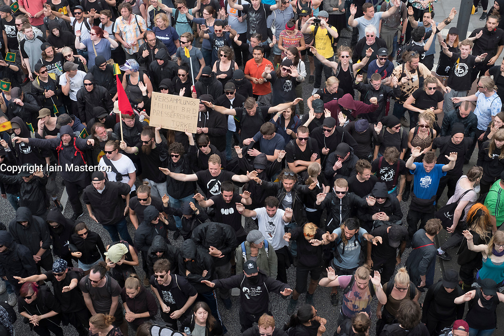 8th July, 2017. Hamburg, Germany. large demonstration march through central Hamburg protesting against G20 Summit taking place in city. Group of black clad anarchistsmarching.