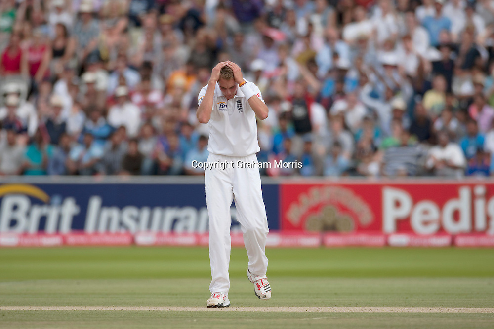 Stuart Broad down as Suresh Raina is not lbw off his bowling in the first npower Test Match between England and India at Lord's Cricket Ground, London.  Photo: Graham Morris (Tel: +44(0)20 8969 4192 Email: sales@cricketpix.com) 25/07/11