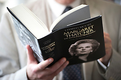 © London News Pictures. 23/04/2013. London, UK. A man reading a copy of 'Margaret Thatcher, The Authorized Biography' by Charles Moore on sale at Waterstones Bookshop in Piccadillly, London following its release today (23/04/2013). Photo credit: Ben Cawthra/LNP.