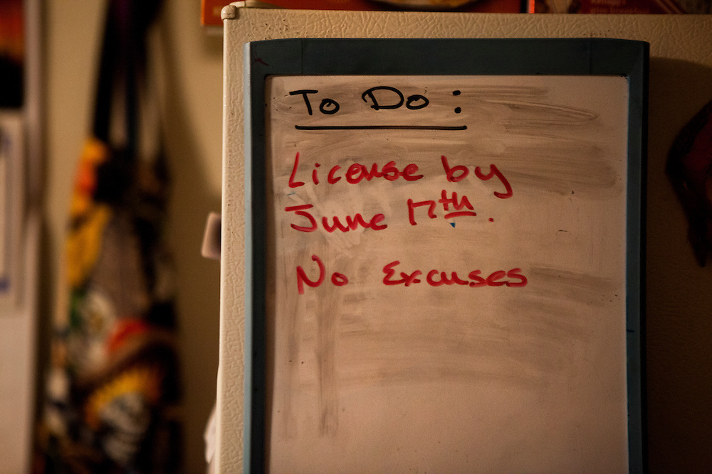 SAN DIEGO, CA - JULY 8, 2014:  A note on the fridge of Jannette Navarro, 22, describes her goal to obtain a drivers license. CREDIT: Sam Hodgson for The New York Times