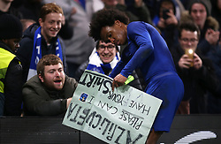 Chelsea's Willian gives a fan his shirt after the final whistle
