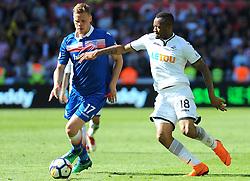 Ryan Shawcross of Stoke City is challenged by Jordan Ayew of Swansea City-Mandatory by-line: Nizaam Jones/JMP- 13/05/2018 - FOOTBALL - Liberty Stadium - Swansea, Wales - Swansea City v Stoke City - Premier League