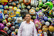 UNITED KINGDOM, London: 25 January 2016 Tony Lewis, director of Amscan (the worlds largest foil balloon manufacturer in the world, stands in front of his collection at The Toy Fair at Olympia, the UK'S only dedicated game and hobby event with more than 260 toy and gaming brands. The fair runs until tomorrow. Rick Findler / Story Picture Agency