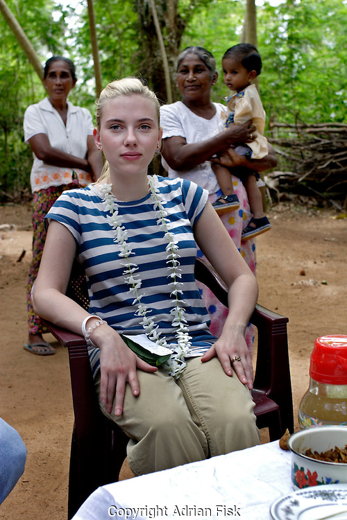 Scarlett relaxes having just sampled the mushrooms grown by locals in an Oxfam initiated program