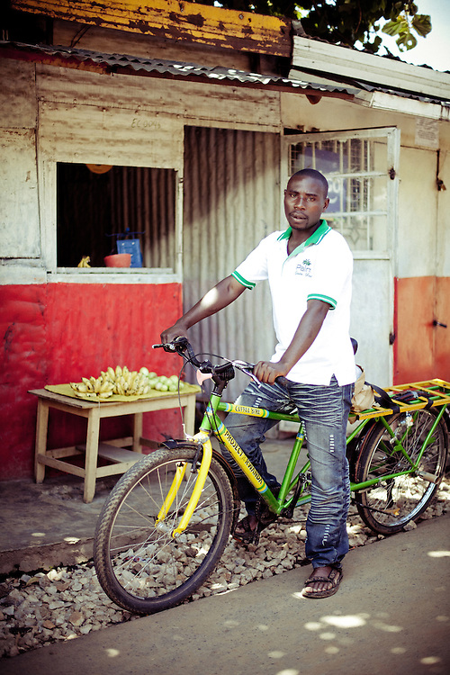 Turimumahoro John Bosco, aged 30, on a Project Rwanda Coffee bicycle
