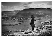 Women descends to her village from 3,000m high plateau west of Kawkaban, Yemen.