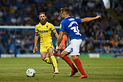 AFC Wimbledon Midfielder, Scott Wagstaff (7) closes down Portsmouth Defender, Brandon Haunstrup (38) during the Carabao Cup match between Portsmouth and AFC Wimbledon at Fratton Park, Portsmouth, England on 14 August 2018.