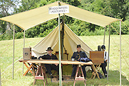 Old Bethpage, New York, USA - July 21, 2012: At left, GUY SMITH of Huntington, NY, portrays Regimental Adjutant, (center) MARK ADLER of Oceanside, NY, portrays Commander, and (right) BOB HANSEN of Sea Cliff, NY, portrays Company Clerk, at re-creation of Camp Scott, a Union Army training camp, at Old Bethpage Village Restoration, to commemorate 150th Anniversary of American Civil War, on Saturday, July 21, 2012.