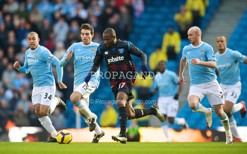 MANCHESTER, ENGLAND - Sunday, January 31, 2010: Portsmouth's John Utaka in action against Manchester City during the Premiership match at the City of Manchester Stadium. (Photo by David Rawcliffe/Propaganda)