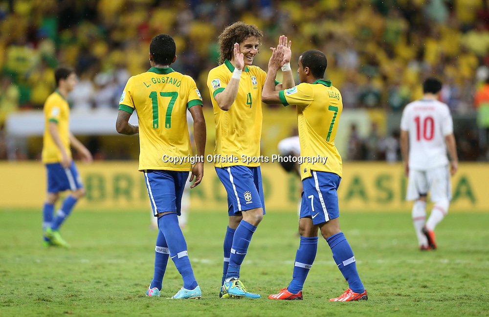 15th June 2013 - FIFA Confederations Cup 2013 - Brazil v Japan - David Luiz of Brazil (C) celebrates with teammate Lucas of Brazil at the final whistle - Photo: Simon Stacpoole / Offside.