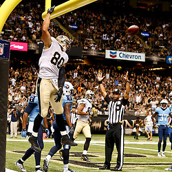 Aug 15, 2014; New Orleans, LA, USA; New Orleans Saints tight end Jimmy Graham (80) celebrates by dunking over the goalpost following a touchdown against the Tennessee Titans during second quarter of a preseason game at Mercedes-Benz Superdome. Mandatory Credit: Derick E. Hingle-USA TODAY Sports