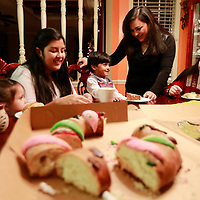 Thomas Wells | BUY AT PHOTOS.DJOURNAL.COM<br /> Daniela Acosta, 18 months, Alejandra, 10, Luis, 3, Maria and Luz Elena enjoy the annual tradition of eating the Rosca De Reyes at their home in Tupelo.