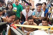 GUANGZHOU, CHINA - OCTOBER 02: (CHINA OUT)<br /> <br /> Chinese Obama Imitator<br /> <br />  Xiao Jiguo (man wearing a tie) who is famous for imitating American President Obama reviews during shooting a comedy at a warehouse on October 2, 2015 in Guangzhou, China. Xiao Jiguo, born in Sichuan province, was well-known as an imitator of American President Barack Hussein Obama after acting in a Chinese entertainment program. He became a star among the commercial events and acted in a comedy during the Chinas National Day Holiday in Guangzhou.<br /> ©Exclusivepix Media