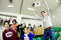 Fans of Korea at Round 4 of IIHF Ice-hockey World Championships Division I Group B match between National teams of Slovenia and South Korea, on April 21, 2010, in Tivoli hall, Ljubljana, Slovenia.  (Photo by Vid Ponikvar / Sportida)