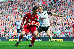 LIVERPOOL, ENGLAND - Sunday, April 11, 2010: Liverpool's Maximiliano Ruben Maxi Rodriguez and Fulham's Erik Nevland during the Premiership match at Anfield. (Photo by: David Rawcliffe/Propaganda)