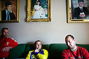 Eliseo (L), Carlos Ferrero and German Ferrero (R), all from the same family and unemployed, sit at Carlos and German parents home living room in Espera, Andalucia, Spain.