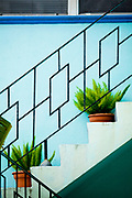 A Miami Modern stair railing on a small apartment building in Miami Beach