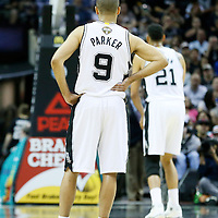 03 April 2015: San Antonio Spurs guard Tony Parker (9) watches San Antonio Spurs forward Tim Duncan (21) at the free throw line during the San Antonio Spurs 123-93 victory over the Denver Nuggets , at the AT&T Center, San Antonio, Texas, USA.